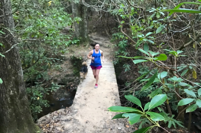 trail runner on sulphur springs trail at Paris Mountain State Park, Greenville, SC